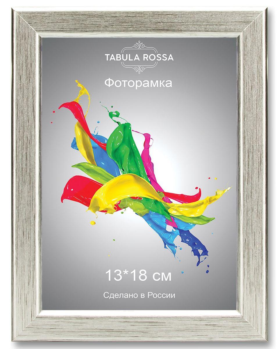 Фоторамка Tabula Rossa, цвет: серебро, 13 х 18 см. ТР 5026ТР 5026Фоторамка Tabula Rossa выполнена в классическом стиле из высококачественного МДФ и стекла, защищающего фотографию. Оборотная сторона рамки оснащена специальной ножкой, благодаря которой ее можно поставить на стол или любое другое место в доме или офисе. Также изделие дополнено двумя специальными креплениями для подвешивания на стену. Такая фоторамка не теряет своих свойств со временем, не деформируется и не выцветает. Она поможет вам оригинально и стильно дополнить интерьер помещения, а также позволит сохранить память о дорогих вам людях и интересных событиях вашей жизни.
