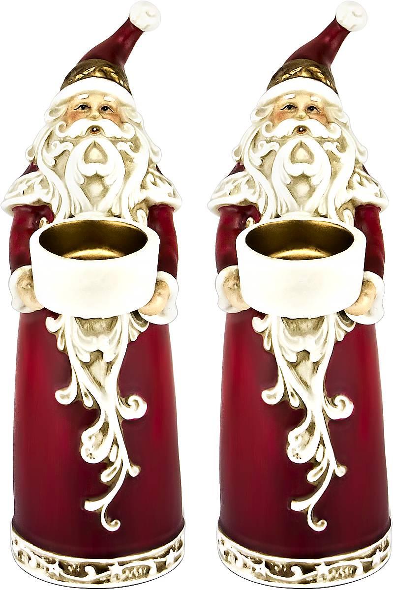 Набор подсвечников Mister Christmas Дед Мороз, высота 22,5 см, 2 штFD-SET6Набор Mister Christmas Дед Мороз состоит из двух подсвечников, выполненных из керамики. Оригинальный дизайн и красочное исполнение создадут праздничное настроение. Каждый подсвечник выполнен в форме Деда Мороза и оснащен емкостью для одной чайной свечи. Вы можете поставить такие подсвечники в любом месте, где они будут удачно смотреться, и радовать глаз. Кроме того такой набор станет отличным вариант подарка для ваших близких и друзей в преддверии Нового года.