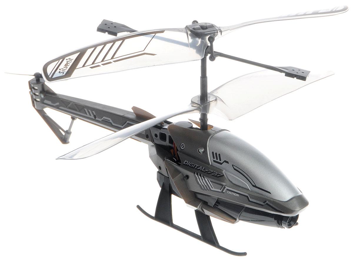Silverlit Вертолет на инфракрасном управлении Spy Cam 3 цвет темно-серый84737_темно-серыйВертолет на инфракрасном управлении Silverlit Spy Cam 3 привлечет внимание не только ребенка, но и взрослого, и станет отличным подарком любителю воздушной техники. Вертолет имеет трехканальное дистанционное управление. Возможные движения: вверх, вниз, вправо, влево. Сверхточное цифровое управление позволяет совершать самые невероятные маневры. Встроенный гироскоп гарантирует стабилизацию полета в любых условиях. Модель вертолета оснащена встроенной камерой с функцией фото и видеосъемки. Разрешение камеры составляет 1280 х 960. Файлы записываются на внутреннюю память. Все фотографии и видеозаписи можно перенести на компьютер с помощью кабеля USB. Вертолет идеально подходит для игры внутри помещения. Каждый полет вертолета будет максимально комфортным и принесет вам яркие впечатления! В комплекте: вертолет, пульт управления, два запасных хвостовых винта, кабель USB, приспособление для замены хвостового пропеллера, инструкция по эксплуатации на русском языке. ...