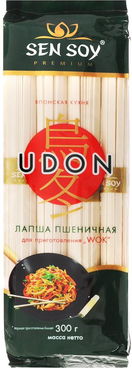 Sen Soy Premium Лапша пшеничная Udon, 300 г4607041132705Лапша Udon - один из основных компонентов японской кухни, столь популярной сегодня во всем мире. Японская лапша готовится из особенно качественной муки с соблюдением древних традиций, поэтому она весьма питательна и полезна для здоровья. Крупная, толстая и плоская лапша Udon очень вкусна в супе мисо, а также в поджаренном виде в качестве гарнира к сашими, подается как холодной, так и горячей. Японцы считают, что в холодном виде эта лапша освежает в жаркую погоду, а в холодное время лучше всего согреет и насытит горячая лапша.