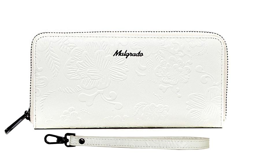 Клатч-кошелек женский Malgrado, цвет: белый. 73005-1820573005-18205# White Клатч MalgradoКлатч-кошелек Malgrado выполнен из натуральной кожи белого цвета высшего качества. Лицевая сторона оформлена тиснением в виде цветочного узора. Клатч-кошелек закрывается на застежку-молнию. Внутри - три отделения для купюр, два кармана для бумаг, карман для мелочи на застежке-молнии и восемь кармашков для дисконтных карт, визиток и кредиток. В комплекте отстегивающийся ремешок для запястья. Модель клатча-кошелька очень актуальна благодаря качеству исполнения, оригинальному дизайну и удобному размеру. Клатч-кошелек упакован в фирменную металлическую коробку.