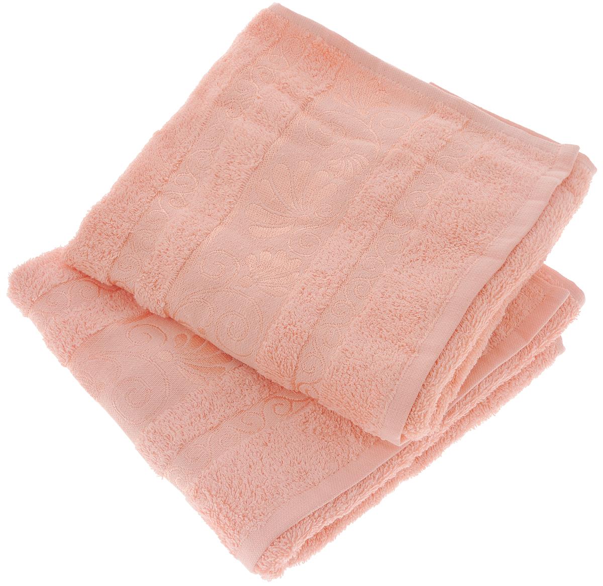 Набор полотенец Tete-a-Tete Цветы, цвет: светло-розовый, 50 х 90 см, 2 штУНП-115-04-2кНабор Tete-a-Tete Цветы состоит из двух махровых полотенец, выполненных из натурального 100% хлопка. Бордюр полотенец декорирован цветочным узором. Изделия мягкие, отлично впитывают влагу, быстро сохнут, сохраняют яркость цвета и не теряют форму даже после многократных стирок. Полотенца Tete-a-Tete Цветы очень практичны и неприхотливы в уходе. Они легко впишутся в любой интерьер благодаря своей нежной цветовой гамме. Набор упакован в красивую коробку и может послужить отличной идеей подарка. Размер полотенец: 50 х 90 см.