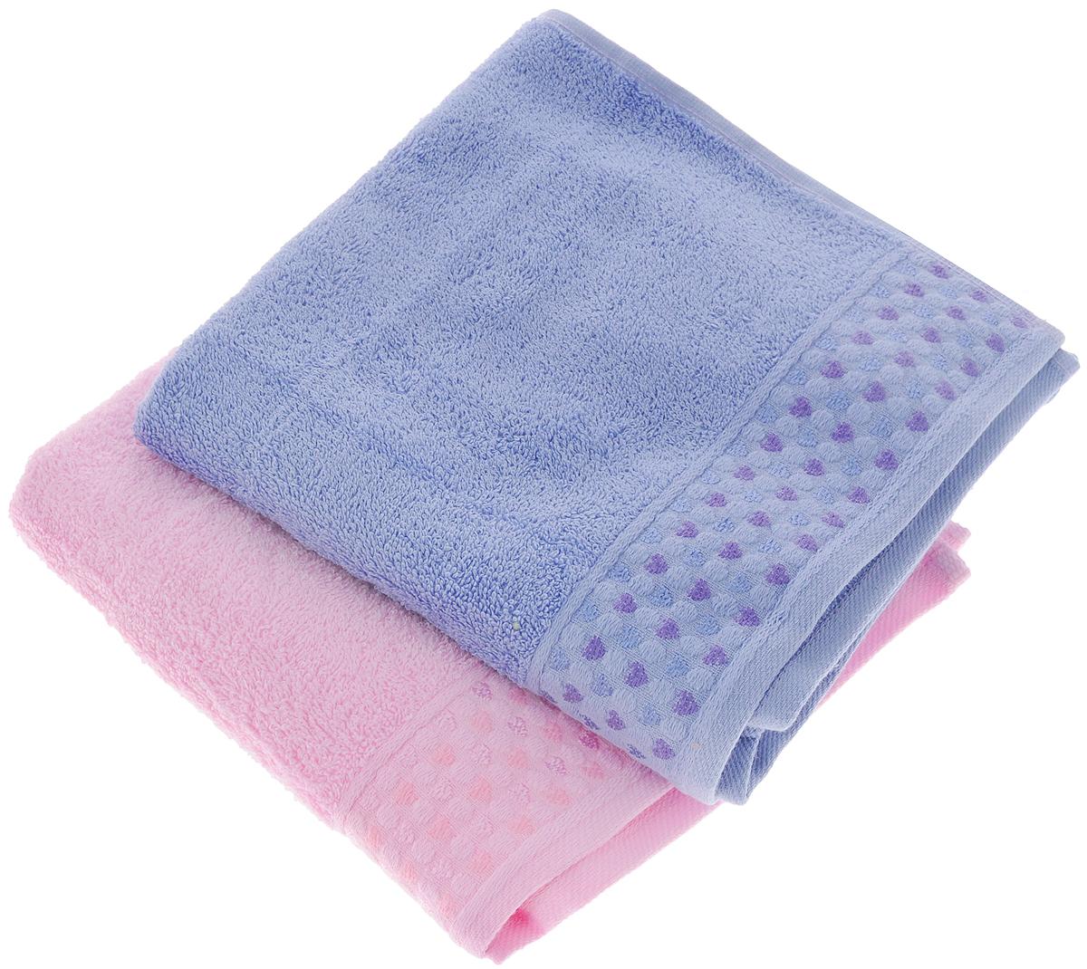 Набор полотенец Tete-a-Tete Сердечки, цвет: розовый, сирень, 50 х 90 см, 2 штУП-107-04-2кНабор Tete-a-Tete Сердечки состоит из двух махровых полотенец, выполненных из натурального 100% хлопка. Бордюр полотенец декорирован рисунком сердечек. Изделия мягкие, отлично впитывают влагу, быстро сохнут, сохраняют яркость цвета и не теряют форму даже после многократных стирок. Полотенца Tete-a-Tete Сердечки очень практичны и неприхотливы в уходе. Они легко впишутся в любой интерьер благодаря своей нежной цветовой гамме. Набор упакован в красивую коробку и может послужить отличной идеей для подарка. Размер полотенец: 50 х 90 см.