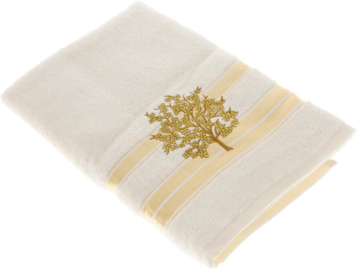 Полотенце Tete-a-Tete Золотое дерево, 70 х 140 смУП-004-01Махровое полотенце Tete-a-Tete Золотое дерево, изготовленное из натурального хлопка, подарит массу положительных эмоций и приятных ощущений. Полотенце отличается нежностью и мягкостью материала, утонченным дизайном и превосходным качеством. Линейка Золотое дерево декорирована вышивкой веточки сакуры. Полотенце прекрасно впитывает влагу, быстро сохнет и не теряет своих свойств после многократных стирок. Махровое полотенце Tete-a-Tete Золотое дерево станет прекрасным дополнением в дизайне ванной комнаты.