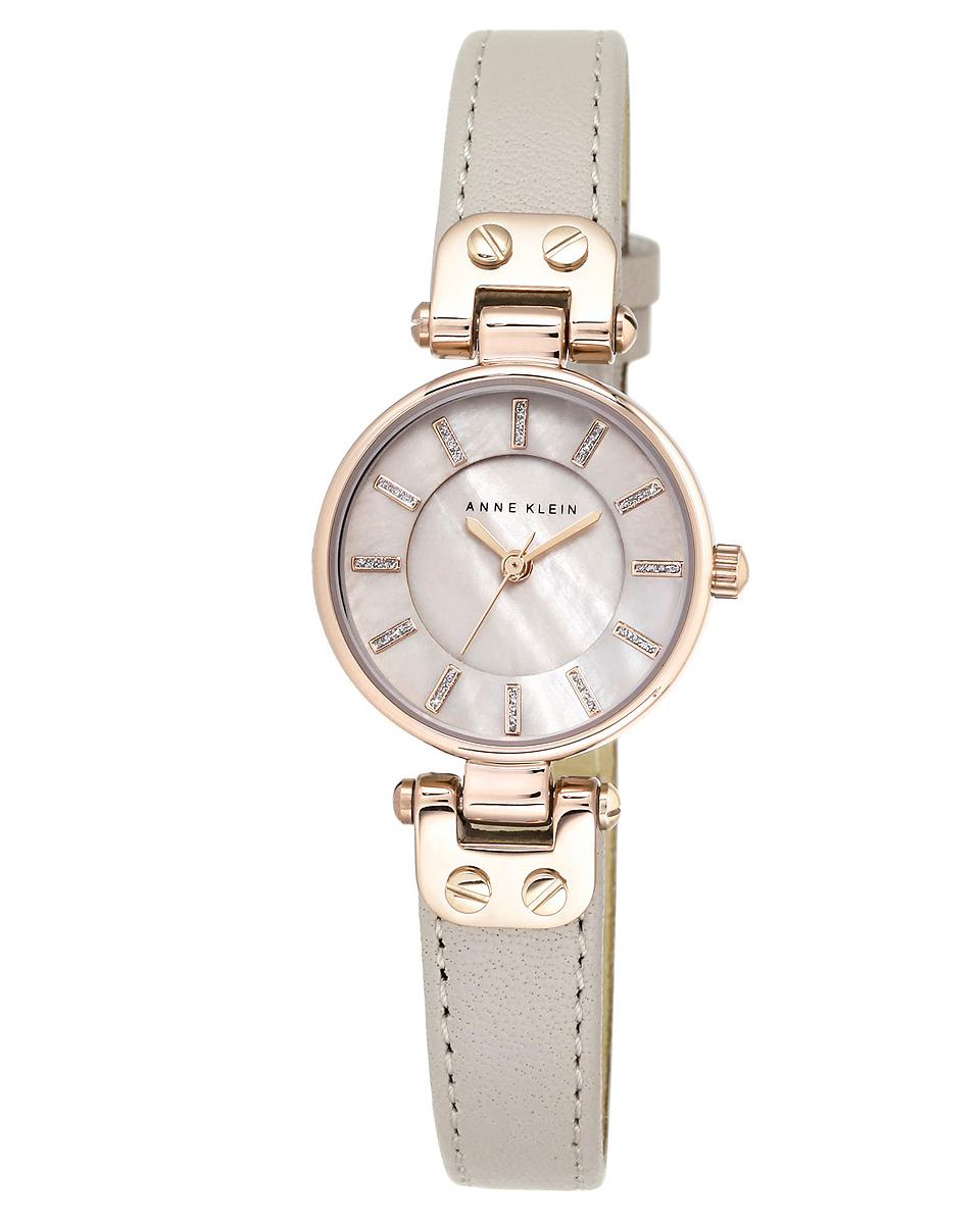 Наручные часы женские Anne Klein, цвет: серый, золотистый. 1950 RGTP1950 RGTPКорпус: металл, PVD покрытие розового цвета, 26 мм, стекло: минеральное, циферблат перламутровый, браслет: кожаный ремешок серого цвета, механизм: кварцевый, водозащита: 3 АТМ
