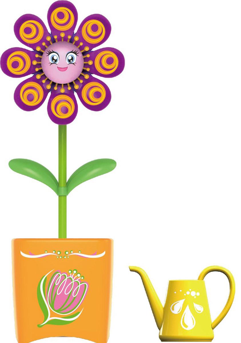 Magic Blooms Интерактивная игрушка Волшебный цветок цвет фиолетовый оранжевый88430S_фиолетовый, оранжевыйИнтерактивная игрушка Magic Blooms Волшебный цветок непременно понравится каждой девочке. Просто прикоснитесь к цветочку и он начнет двигаться и петь. Если вы запишете пару слов, он сможет их повторить под музыку. Также вы можете создать хор, объединив несколько Magic Blooms вместе, они будут петь синхронно. Игрушка выполнена из нетоксичного и абсолютно безопасного для детей материала. В комплект входят волшебный цветочек и лейка. Для работы цветочка рекомендуется докупить 3 батарейки напряжением 1,5V типа AAA (товар комплектуется демонстрационными).