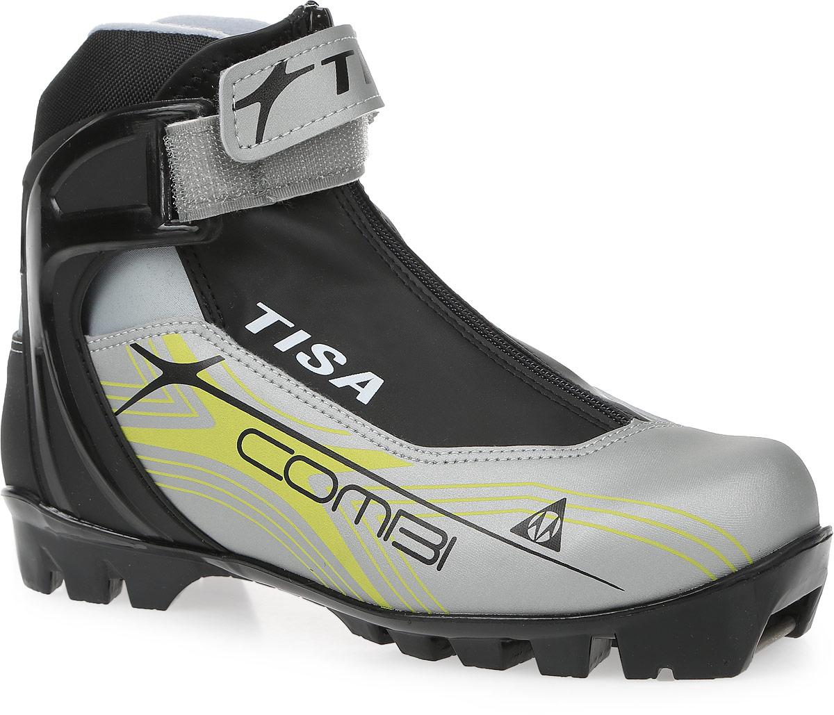 Ботинки лыжные беговые Tisa Combi NNN, цвет: черный, серый, салатовый. Размер 41S75715Лыжные ботинки Tisa Combi NNN выполнены из искусственных материалов в классическом стиле и предназначены для лыжных прогулок и туризма. Язык защищен текстильной вставкой на застежке-молнии. Подкладка, исполненная из мягкого флиса и искусственного меха, защитит ноги от холода и обеспечит уют. Верх изделия оформлен удобной шнуровкой с петлями из текстиля. Вставки в мысовой и пяточной частях предназначены для дополнительной жесткости. Манжета Control Cuff поддерживает голеностоп. Подошва системы NNN выполнена из полимерного термопластичного материала. С одной из боковых сторон лыжные ботинки дополнены принтом в виде логотипа бренда.