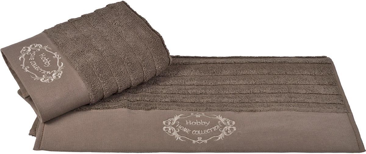 Полотенце Hobby Home Collection Zafira, цвет: коричневый, 70 х 140 см1607000116Полотенце Hobby Home Collection Zafira выполнено из 100% хлопка. Изделие отлично впитывает влагу, быстро сохнет, сохраняет яркость цвета и не теряет форму даже после многократных стирок. Такое полотенце очень практично и неприхотливо в уходе. А простой, но стильный дизайн полотенца позволит ему вписаться даже в классический интерьер ванной комнаты.