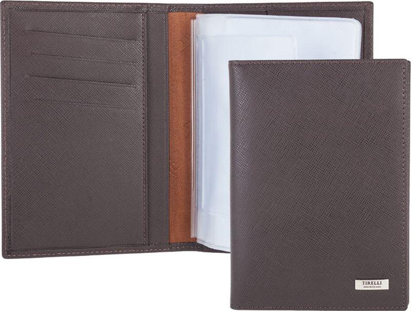 Зажим для денежных банкнот Tirelli, цвет: коричневый. 15-305-0315-305-03Бумажник водителя Tirelli изготовлен из натуральной кожи. Внутри содержится съемный блок из 6 прозрачных пластиковых файлов разного размера для автодокументов. С внутренней стороны обложки имеется 4 прорезных кармашка для пластиковых карт и 2 потайных кармашка. Стильный бумажник не только защитит ваши документы, но и станет стильным аксессуаром, подчеркивающим ваш образ. Изделие упаковано в подарочную коробку синего цвета с логотипом фирмы Tirelli