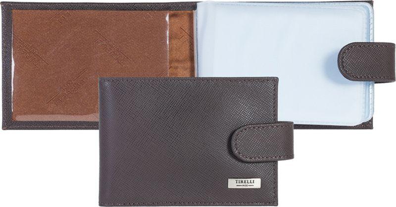 Визитница женская Tirelli, цвет: коричневый. 15-313-0315-313-03Футляр для карточек Tirelli изготовлен из натуральной кожи. Футляр закрывается хлястиком на кнопку, оформлен фирменным логотипом. Внутри имеется 10 двусторонних кармашков из прозрачного пластика для хранения пластиковых карт, визиток, дисконтных карт и т. п. Такой футляр не только поможет сохранить внешний вид ваших документов и защитит их от повреждений, но и станет ярким аксессуаром, который подчеркнет ваш образ.
