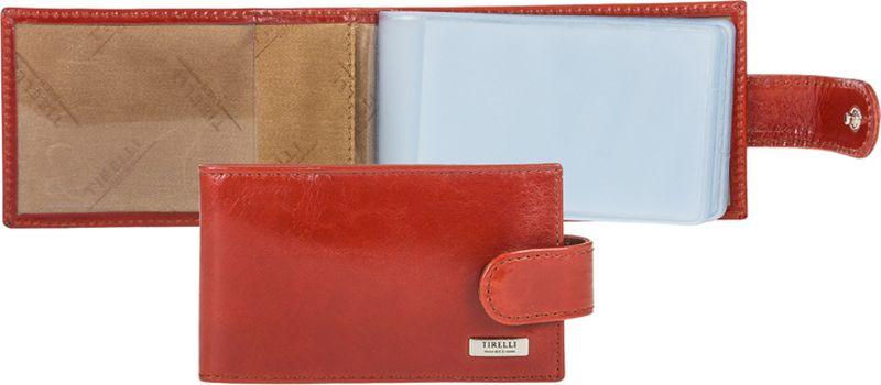 Визитница женская Tirelli, цвет: коралловый. 15-313-2515-313-25Визитница Tirelli изготовлена из натуральной кожи. Модель закрывается хлястиком на кнопку, оформлена фирменным логотипом. Внутри имеется 10 двусторонних кармашков из прозрачного пластика для хранения пластиковых карт, визиток, дисконтных карт и т. п. Такая визитница не только поможет сохранить внешний вид ваших документов и защитит их от повреждений, но и станет ярким аксессуаром, который подчеркнет ваш образ.