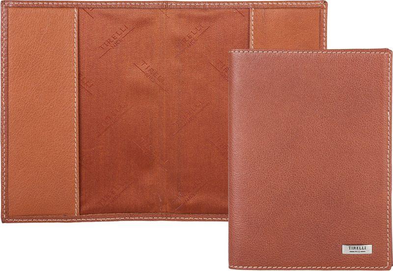 Обложка для паспорта Tirelli, цвет: светло-коричневый. 15-317-1115-317-11Обложка для паспорта Tirelliизготовлена из натуральной кожи. На внутреннем развороте - два вертикальных кармана из натуральной кожи. Такая обложка не только поможет сохранить внешний вид ваших документов и защитит их от повреждений, но и станет ярким аксессуаром, который подчеркнет ваш образ. Изделие упаковано в подарочную коробку с логотипом фирмы Tirelli.