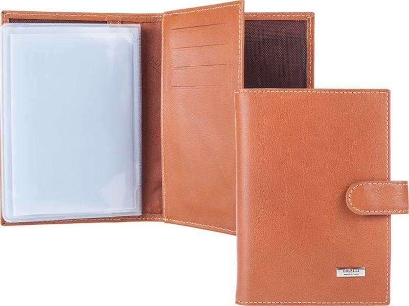 Обложка для автодокументов Tirelli, цвет: светло-коричневый. 15-331-1115-331-11Бумажник водителя изготовлен из натуральной кожи, закрывается хлястиком на кнопку, раскладывается пополам. Внутри содержится съемный блок из 5 прозрачных пластиковых файлов для автодокументов, четыре кармашка для пластиковых карт, открытый карман из кожи. Имеется специальное отделение для паспорта. Стильный бумажник не только защитит ваши документы, но и станет стильным аксессуаром, подчеркивающим ваш образ.