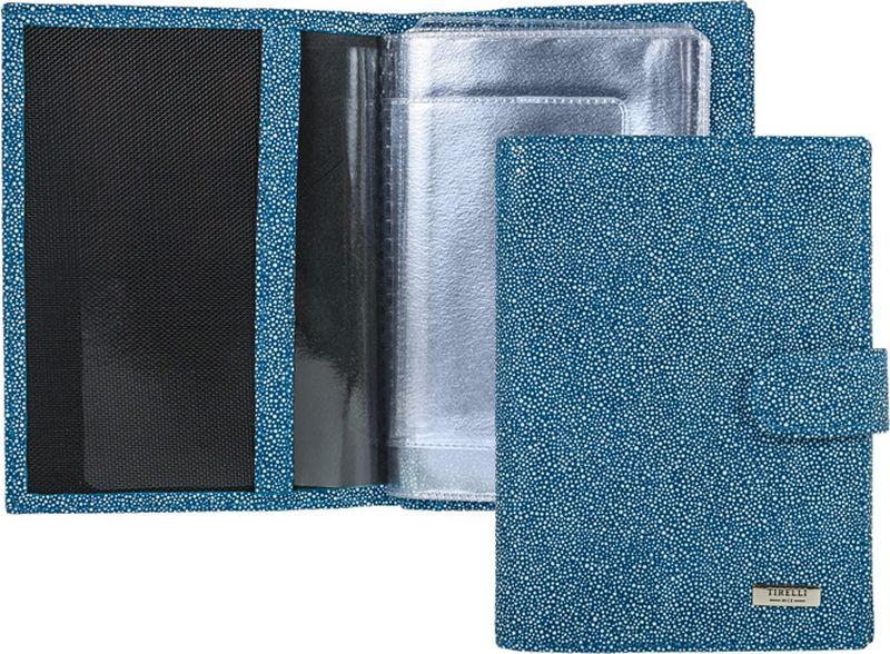 Обложка для автодокументов женская Tirelli, цвет: синий, белый. 15-331-2815-331-28Бумажник водителя изготовлен из натуральной кожи, закрывается хлястиком на кнопку, раскладывается пополам. Внутри содержится съемный блок из 5 прозрачных пластиковых файлов для автодокументов, четыре кармашка для пластиковых карт, открытый карман из кожи. Имеется специальное отделение для паспорта. Стильный бумажник не только защитит ваши документы, но и станет стильным аксессуаром, подчеркивающим ваш образ.