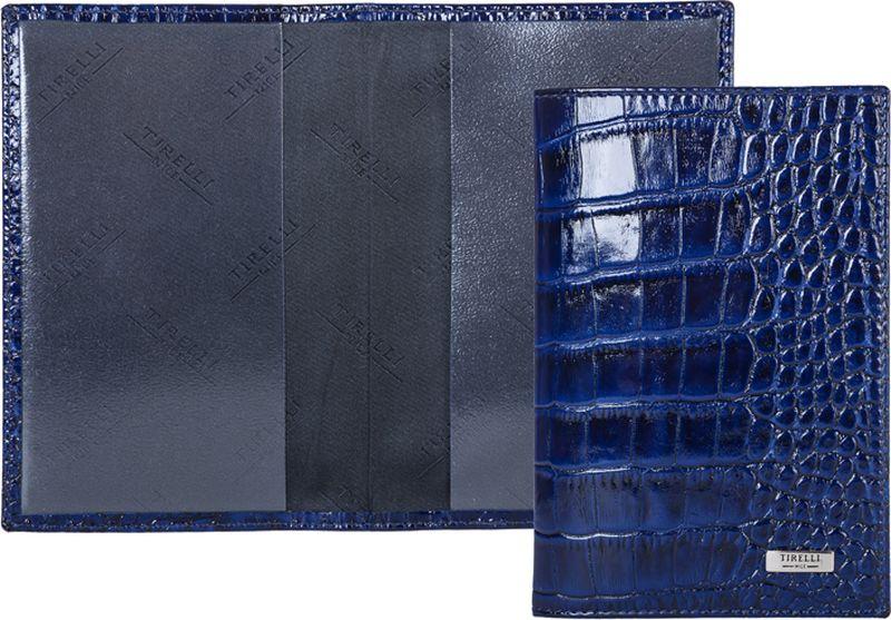 Обложка для паспорта женская Tirelli, цвет: синий. 15-333-1515-333-15Обложка для паспорта, выполненная из натуральной кожи. Такая обложка не только поможет сохранить внешний вид ваших документов и защитит их от повреждений, но и станет стильным аксессуаром, идеально подходящим вашему образу. Яркая и оригинальная обложка подчеркнет вашу индивидуальность и изысканный вкус. Обложка для паспорта стильного дизайна может быть достойным и оригинальным подарком.