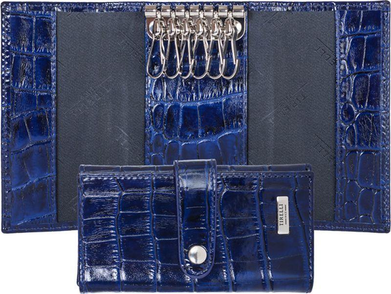 Ключница женская Tirelli, цвет: синий. 15-334-1515-334-15Ключница Tirelli изготовлена из натуральной кожи. Ключница закрывается при помощи хлястика на кнопку. Внутри расположено шесть металлических карабинов для ключей Этот аксессуар станет замечательным подарком человеку, ценящему качественные и практичные вещи.