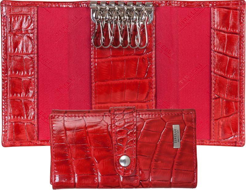 Ключница женская Tirelli, цвет: красный. 15-334-1615-334-16Ключница Tirelli изготовлена из натуральной кожи. Ключница закрывается при помощи хлястика на кнопку. Внутри расположено шесть металлических карабинов для ключей Этот аксессуар станет замечательным подарком человеку, ценящему качественные и практичные вещи.