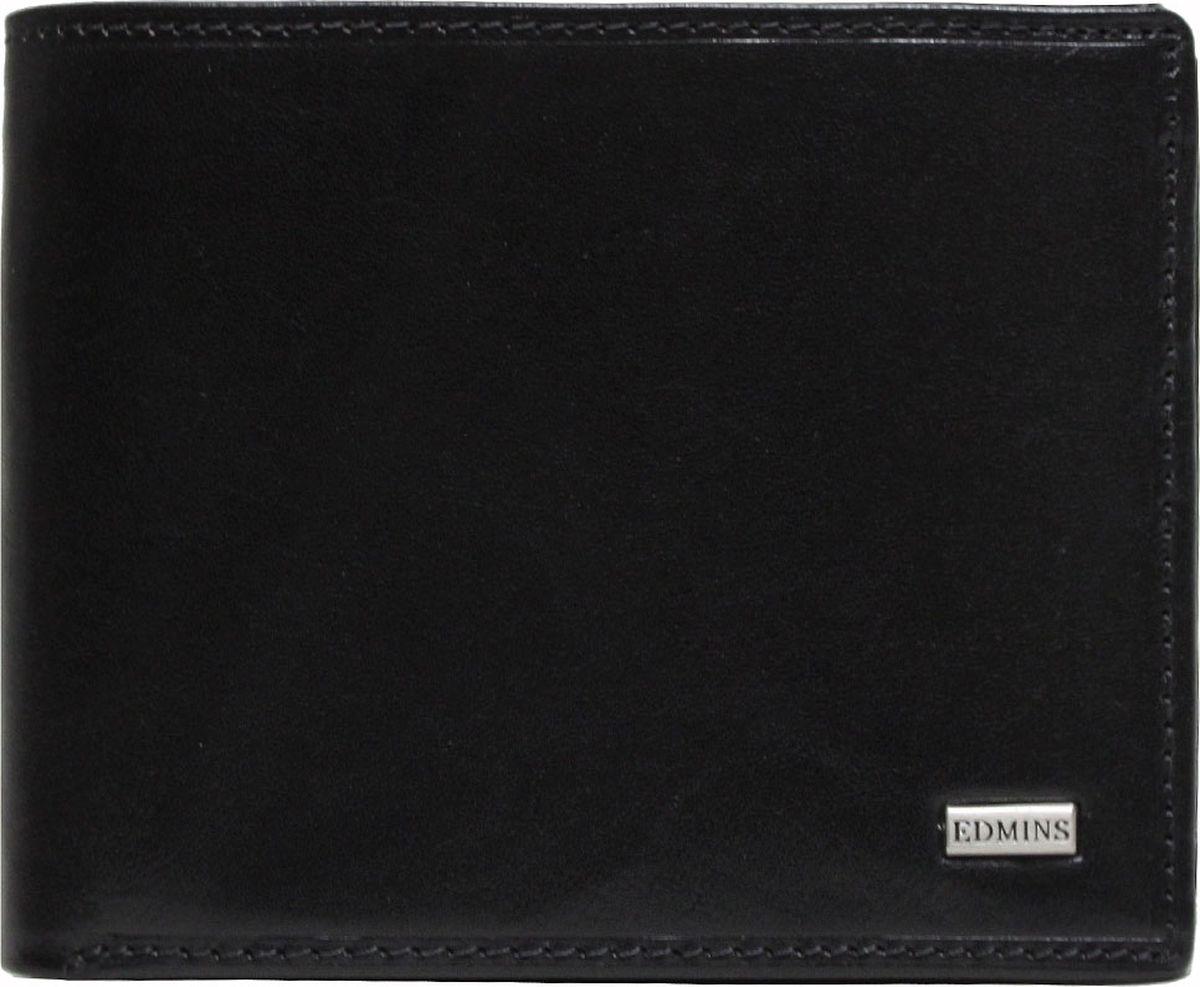 Портмоне мужское Edmins, цвет: черный. 2667 ML ED2667 ML ED blackКомпактное портмоне Edmins выполнено из натуральной кожи с гладкой фактурой и оформлено металлическим элементом с символикой бренда. Модель раскладывается пополам и закрывается хлястиком на кнопку. Внутренний функционал: одно отделение для купюр, восемь накладных кармашков для визиток и пластиковых карт, отделение для чеков и мелких бумаг на молнии, карман со вставкой из прозрачного ПВХ. Отделение для мелочи закрывается на кнопку. В коллекциях кожгалантереи Edmins удачно сочетаются итальянская классика и шведский прагматизм, новаторство молодых дизайнеров и работы именитых мастеров, строгая цветовая гамма и смелые эксперименты с цветом. Изделия Edmins, разработанные в Италии, отличает высокое качество кожи, прекрасная износостойкость и актуальность коллекций. Изделие упаковано в фирменную коробку.