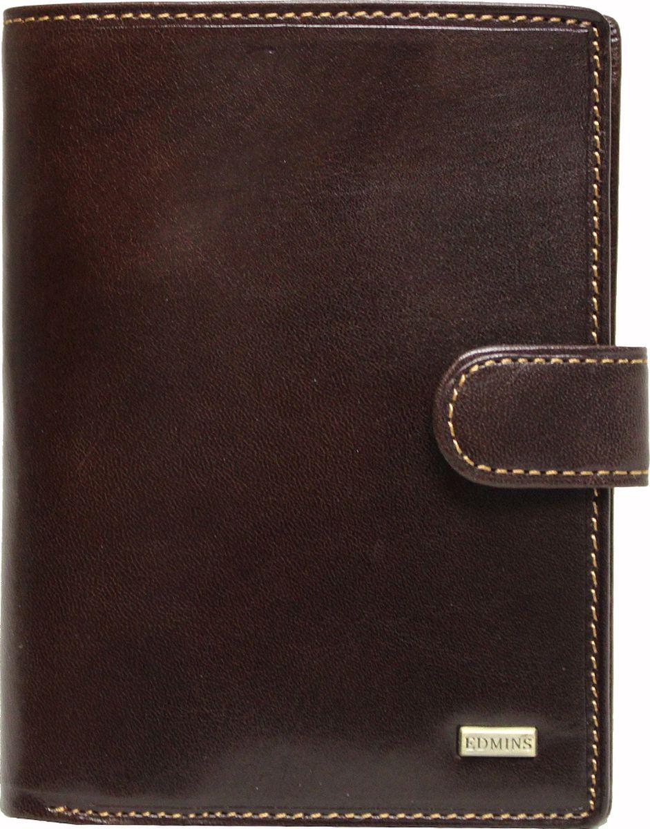 Обложка для документов Edmins, цвет: коричневый. 2242 ML ED2242 ML ED brownОбложка для документов Edmins выполнена из натуральной кожи с естественной фактурой и оформлена металлическим элементом с символикой бренда и контрастной отстрочкой. Подкладка изготовлена из полиэстера. Изделие раскладывается пополам и закрывается хлястиком на кнопку. Внутри размещены несколько накладных кармашков из прозрачного ПВХ, накладные карманы для карточек и визиток, а также горизонтальное отделение для купюр или бумаг. В коллекциях кожгалантереи Edmins удачно сочетаются итальянская классика и шведский прагматизм, новаторство молодых дизайнеров и работы именитых мастеров, строгая цветовая гамма и смелые эксперименты с цветом. Изделия Edmins, разработанные в Италии, отличает высокое качество кожи, прекрасная износостойкость и актуальность коллекций. Изделие упаковано в фирменную коробку.