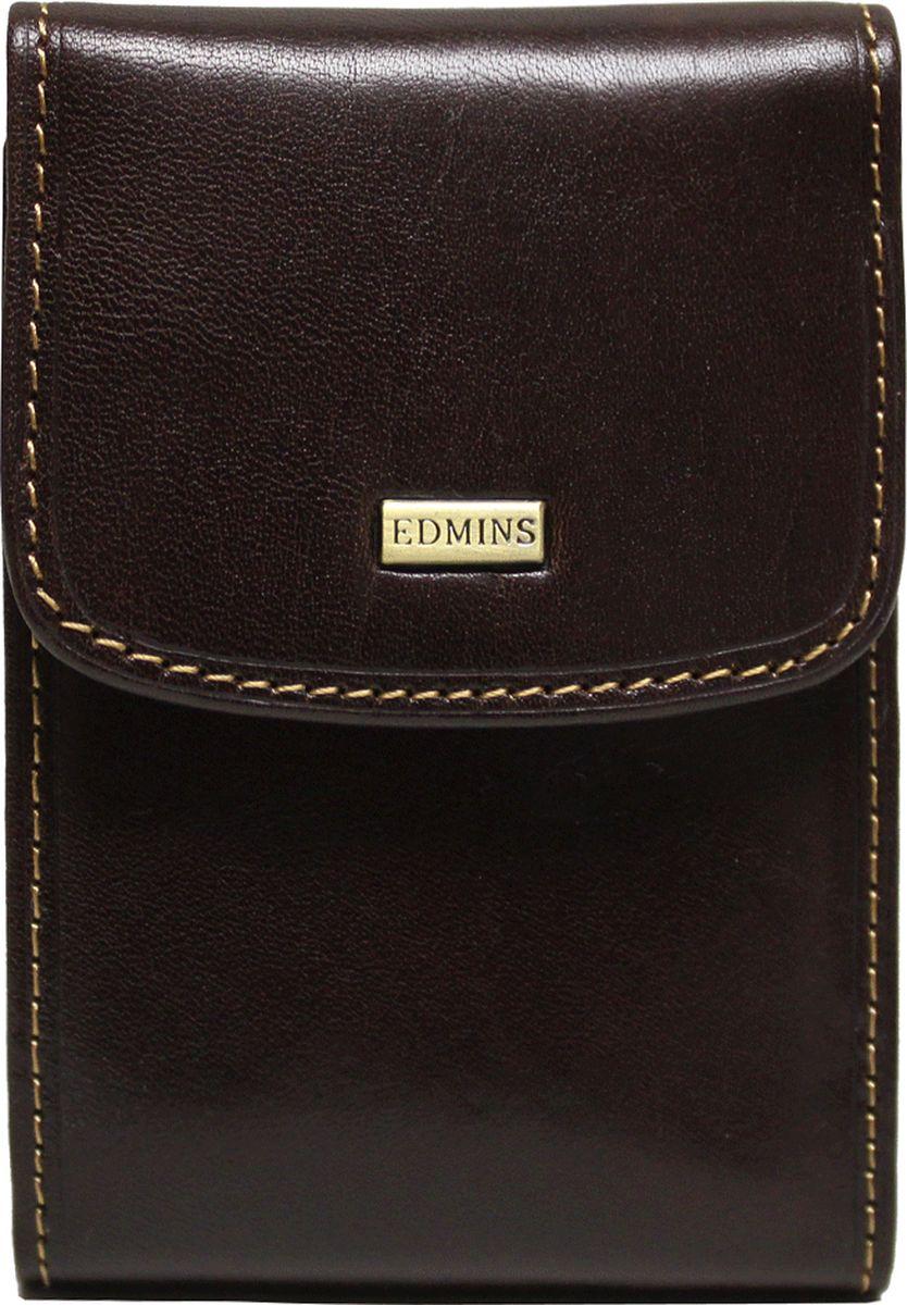 Визитница Edmins, цвет: коричневый. 1703-S-ML-ED1703-S-ML-ED brownВизитница вертикальная Edmins выполнена из натуральной кожи с естественной фактурой и декорирована металлическим элементом с символикой бренда и контрастной отделочной строчкой. Изделие закрывается клапаном на кнопку. Внутри расположен вкладыш, состоящий из десяти файлов, который вмещает в себя двадцать визитных карточек и десять кредитных. Изделие поставляется в фирменной коробке. Стильная визитница станет отличным подарком для человека ценящего качественные и практичные вещи.