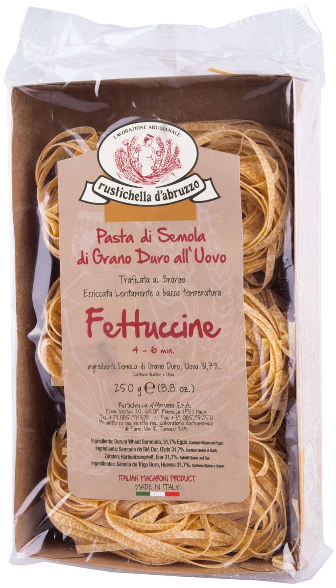 Rustichella паста Фетучини, 250 г88195Паста Rustichella Фетучини - это особый вид итальянских макаронных изделий, тонких и широких. Принцип их варки схожий с обычными макаронами. Как и любая паста, к столу они подаются с соусом. Универсальный вариант этого блюда - фетучини с грибами. Rustichella - итальянская фирма, специализирующаяся на производстве макаронных изделий из твердых сортов пшеницы. Для изготовления макарон используется отборная пшеничная мука, замешанная с чистой горной водой, что придает макаронным изделиям уникальную консистенцию и вкус, который не сравнится ни с чем.