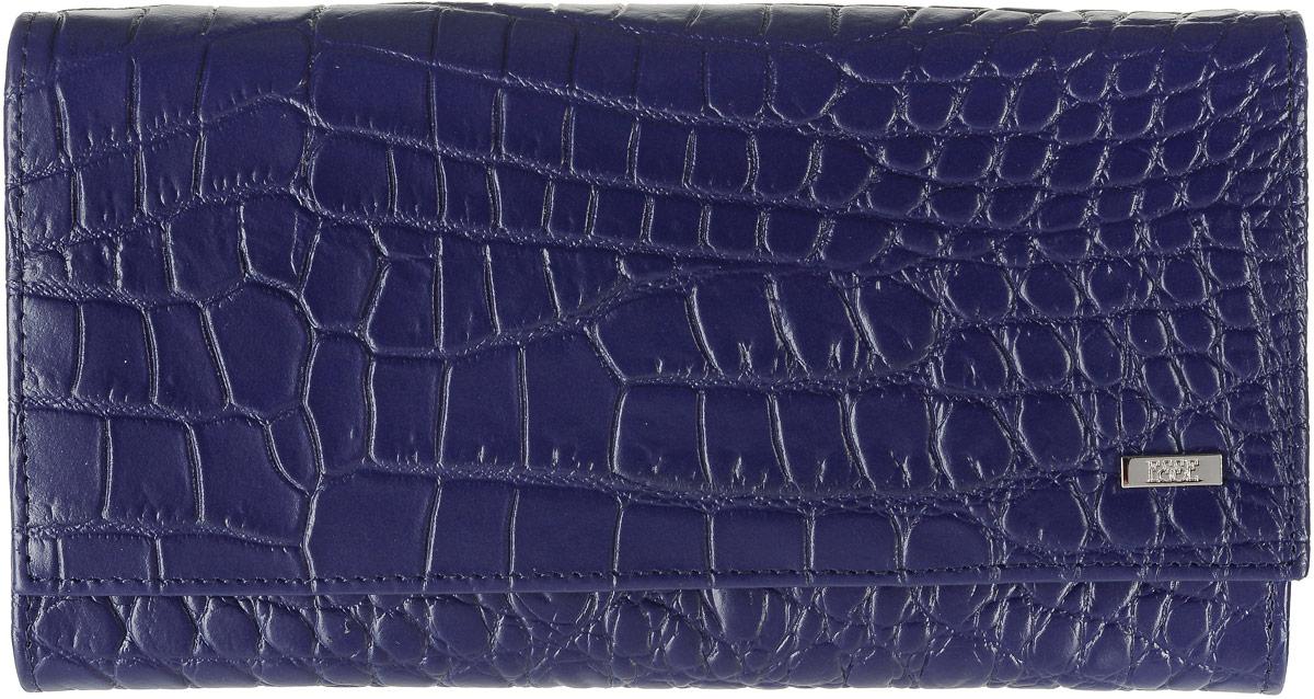 Портмоне женское Esse Чарли, цвет: темно-синий. GCHL00-00ML00-FH508O-K100GCHL00-00ML00-FH508O-K100Стильное женское портмоне Esse Чарли изготовлено из натуральной кожи с тиснением под крокодила. Портмоне закрывается на клапан с кнопкой. Внутри находятся три отделения для купюр, карман из прозрачного пластика, два потайных кармана, карман на застежке-молнии, шесть прорезных кармашков для пластиковых карт, один карман с прозрачным пластиковым окошечком и отделение для мелочи на застежке-молнии. Снаружи, на задней стенке предусмотрен карман на застежке-молнии. Портмоне упаковано в фирменную коробку. Такое портмоне станет замечательным подарком человеку, ценящему качественные и практичные вещи.