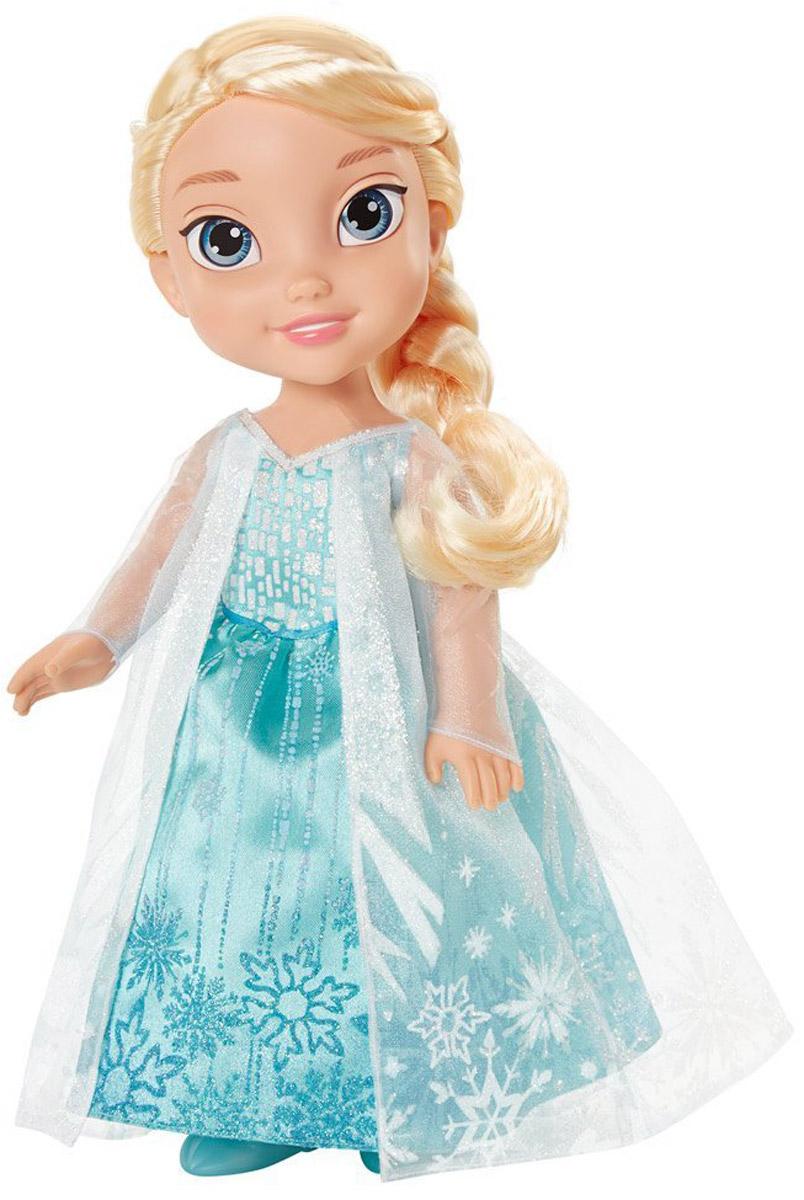 Disney Frozen Кукла Малышка Эльза310020-91383_Toddler ElsaКукла Disney Frozen Малышка Эльза - это милая куколка, которая создана по образу героини популярного диснеевского мультфильма Холодное сердце. У Эльзы большие и яркие глаза, милые и аккуратные черты лица, на щечках - розовый румянец, а губки переливаются нежно- розовым цветом. У юной принцессы подвижные ручки и ножки. Также Эльза может поворачивать голову. Тело куколки изготовлено из прочного материала, поэтому она хорошо принимает различные позы, в которых без труда сможет застыть во время игры. Эльза одета в светло-бирюзовое длинное платье из блестящей ткани. Легкая полупрозрачная накидка белого цвета делает образ маленькой принцессы нарядным и торжественным. У Эльзы длинные белоснежные волосы, которые можно заплетать в косы или пучки, или же оставить распущенными. С куклой вы сможете придумать множество игровых сюжетов, а также воплотить в жизнь любимые моменты из мультфильма Холодное сердце.