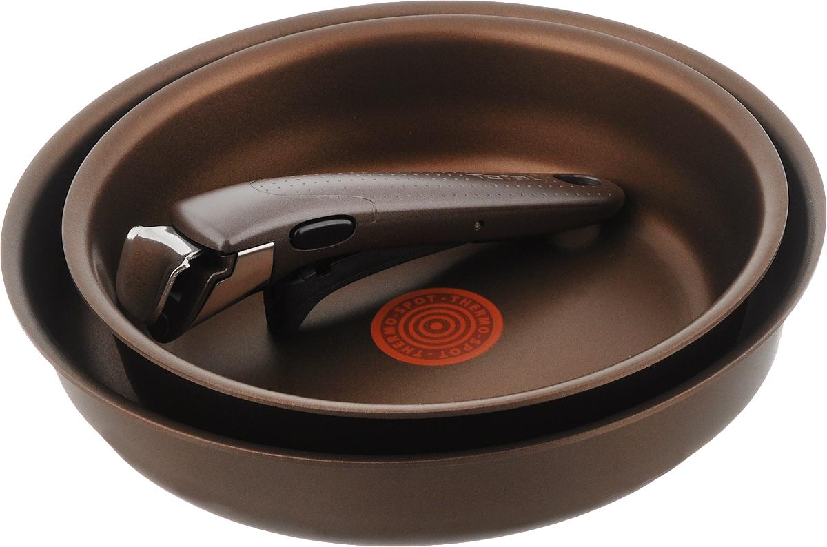 Набор сковородок Tefal Ingenio Authentic, с антипригарным покрытием, со съемной ручкой, 3 предметаL850S274Набор Tefal Ingenio Authentic состоит из 2 сковородок, изготовленных из литого алюминия с внутренним антипригарным покрытием Titanium PRO. Экстра - толстое дно для длительного сохранения тепла. Имеется индикатор нагрева Thermo-Spot, который становится равномерно красным при достижении оптимальной температуры. Мгновенное распределение тепла, устойчивость к деформации выше в 50 раз. Съемная ручка Ingenio 5 Premium выполнена из бакелита и выдерживает до десяти килограмм. Благодаря такой ручке посуда складывается друг в друга по принципу матрешки и хранится, занимая минимум места. К тому же, это значит, что сковороды можно использовать в духовке. С таким набором вы сможете готовить разнообразные блюда. Посуда занимает минимум места и дарит вам максимум возможностей. Можно мыть в посудомоечной машине. Подходит для всех типов плит, включая индукционные. Можно использовать в духовке с максимальной температурой нагрева 250°С (без...