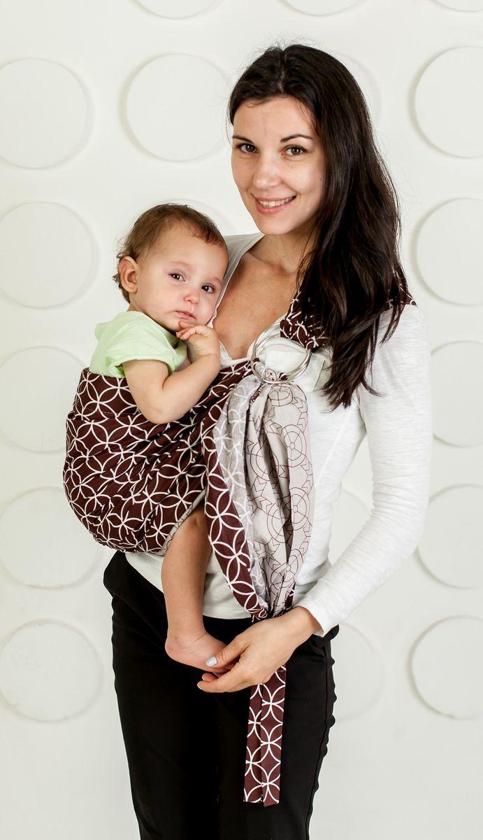 Мамарада Слинг с кольцами Амулет Размер S (42-44)778Слинг с кольцами позволяет носить ребенка как горизонтально в положении Колыбелька так и в вертикальном положении. В слинге в положении Колыбелька малыш располагается точно так же, как у мамы на руках, что особенно актуально для новорожденного. Ткань слинга равномерно поддерживает спинку малыша по всей длине. Малышу комфортно и спокойно рядом с мамой. Мама в это время может заняться полезными делами или прогуляться. В положении Колыбелька очень удобно кормить ребенка грудью. В слинге в вертикальном положении ножки ребенка разводятся лягушкой. Это положение снимает нагрузку с копчика — ребенок поддерживается нижним бортиком слинга под коленками, а верхним прижимается к маминой груди. Положение ребенка в слинге лягушкой – прекрасная профилактика дисплазии. Слинг из пакистанской бязи (хлопок 100%) с металлическими кольцами. При изготовлении этого вида ткани используются очень тонкие нити, но плотно переплетенные, за счет чего ткань становится тонкой,...