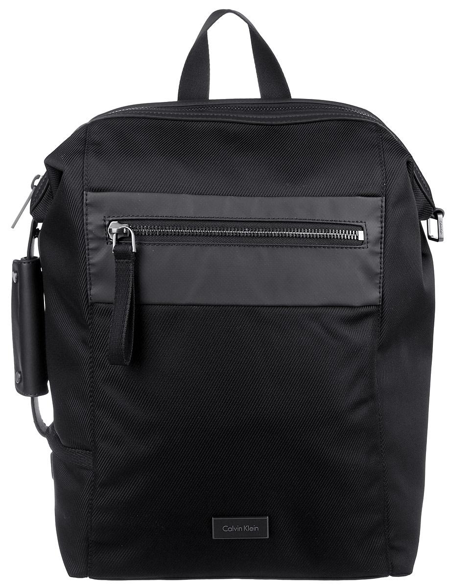 Рюкзак мужской Calvin Klein Jeans, цвет: черный. K50K502285_0010K50K502285_0010Стильный мужской рюкзак Calvin Klein Jeans выполнен из полиуретана, полиамида и полиэстера. Изделие имеет одно вместительное отделение, которое закрывается на застежку-молнию. Внутри изделия расположены мягкий карман для ноутбука, закрывающийся на широкий хлястик с липучкой, прорезной карман на застежке-молнии и ремешок для ключей на кнопке. Снаружи, на передней стенке расположен прорезной карман на застежке-молнии. Мягкая спинка из сетчатого материала комфортна при движении. На задней стенке, за мягкой спинкой предусмотрен карман. Рюкзак оснащен широкими лямками регулируемой длины и ручкой для переноски в руке. Одна из боковых сторон оснащена дополнительной ручкой.