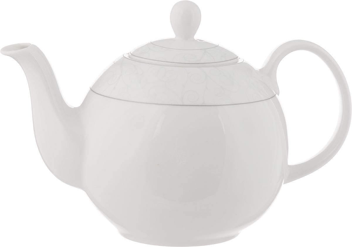 Чайник заварочный Esprado Florestina, 1,22 лFLOL12SE306Чайник заварочный Esprado Florestina изготовлен из высококачественного костяного фарфора и декорирован изящным узором по верхнему краю. Такой дизайн, несомненно, придется по вкусу и любителям классики, и тем кто предпочитает современный стиль. Такой чайник украсит ваш кухонный стол, а также станет замечательным подарком к любому празднику. Можно использовать в микроволновой печи и мыть в посудомоечной машине. Диаметр чайника (по верхнему краю): 5,5 см. Высота чайника (с учетом крышки): 15 см. Длина чайника (с учетом ручки и носика): 21 см.