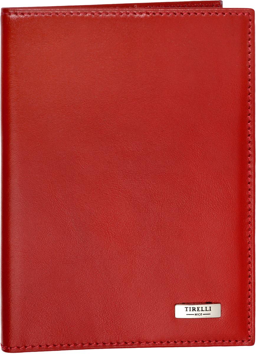 Обложка для паспорта женская Tirelli, цвет: красный. 15-317-0615-317-06Обложка для паспорта Tirelli изготовлена из натуральной кожи. На внутреннем развороте два вертикальных кармана из натуральной кожи. Дополнена модель металлической пластиной с названием бренда.