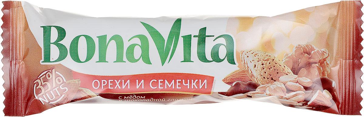 Bona Vita Батончик ореховый с семенами подсолнечника орехами и медом в шоколадной глазури, 35 г4607061252643Ореховые батончики Bona Vita выпускаются отечественным производителем в соответствии с европейскими стандартами качества и безопасности. Они сочетают в себе полезные свойства различных орехов (миндаль, грецкий орех, фисташки, арахис, бразильский орех, кокос), сваренных с медом и фруктозой, с добавлением злаков и сушеных фруктов, покрытые шоколадной или йогуртовой глазурью. Ореховые батончики Bona Vita - это полезное и вкусное лакомство для всей семьи! Уважаемые клиенты! Обращаем ваше внимание, что полный перечень состава продукта представлен на дополнительном изображении.