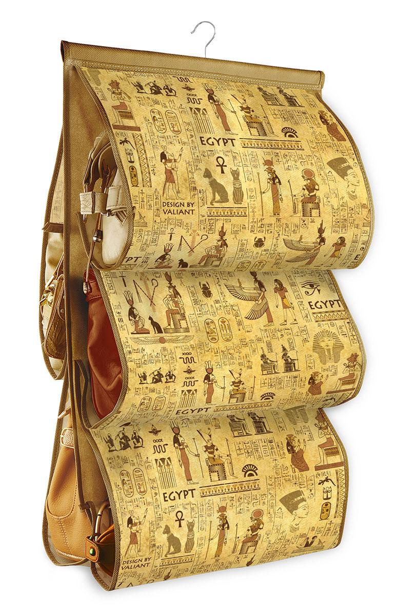 Кофр подвесной для сумок Valiant Egypt, с вешалкой, 5 секций, 42 х 72 смEG-P5Подвесной кофр Valiant Egypt, изготовленный из высококачественного нетканого материала с оригинальным принтом, предназначен для хранения сумок. Благодаря специальному крючку, кофр можно повесить в шкафу как обычную вешалку, а эстетичный дизайн гармонично смотрится в любом интерьере. Изделие имеет 5 секций. Подвесной кофр Ренессанс - это новый взгляд на систему хранения - теперь хранить вещи не только удобно, но и красиво. Размер кофра: 42 х 72 см. Количество секций: 5.
