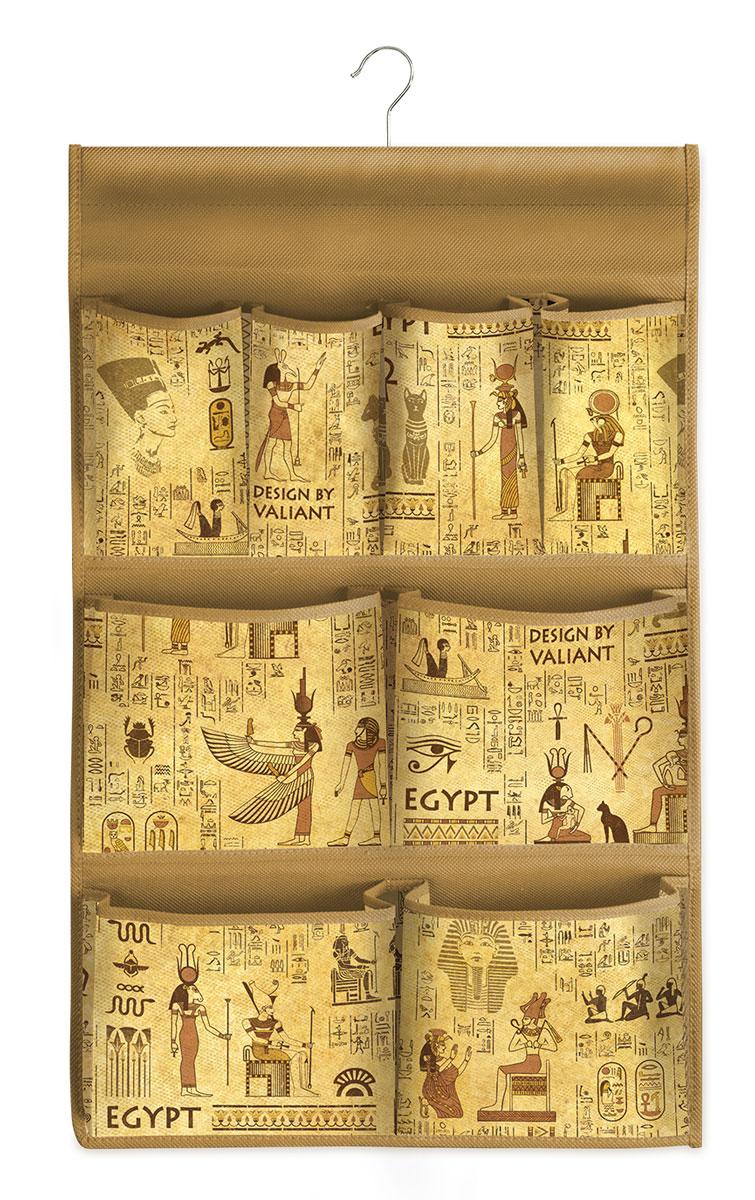 Кофр подвесной для хранения Valiant Egypt, с вешалкой, 8 карманов, 36 х 60 смEG-P8Привнести в интерьер гардероба частичку загадочного Египта теперь возможно с новой системой хранения Egypt Collection. Многофункциональность системы хранения Egypt Collection обеспечивает надежное и бережное хранение вещей. В коллекции удобные чехлы для одежды, короба стеллажные, кофры и органайзеры для хранения вещей. Все модели Egypt Collection удобны в использовании и обеспечивают бережное хранение вещей. Система хранения Egypt Collection от VALIANT представлена в фирменной упаковке, выполненной в едином стиле. СТИЛЬНАЯ ИНФОРМАТИВНАЯ УПАКОВКА С ИНТЕРЬЕРНОЙ ВИЗУАЛИЗАЦИЕЙ СИСТЕМЫ ХРАНЕНИЯ Egypt COLLECTION ЭФФЕКТНО ВЫДЕЛЯЕТСЯ СРЕДИ АНАЛОГОВ FACE BACK Оригинальная прозрачная упаковка с крючком позволяет: — организовать коллекционную выкладку товара в магазине — продемонстрировать все достоинства товара покупателю. Покупатель может собрать собственную систему хранения в едином стиле.