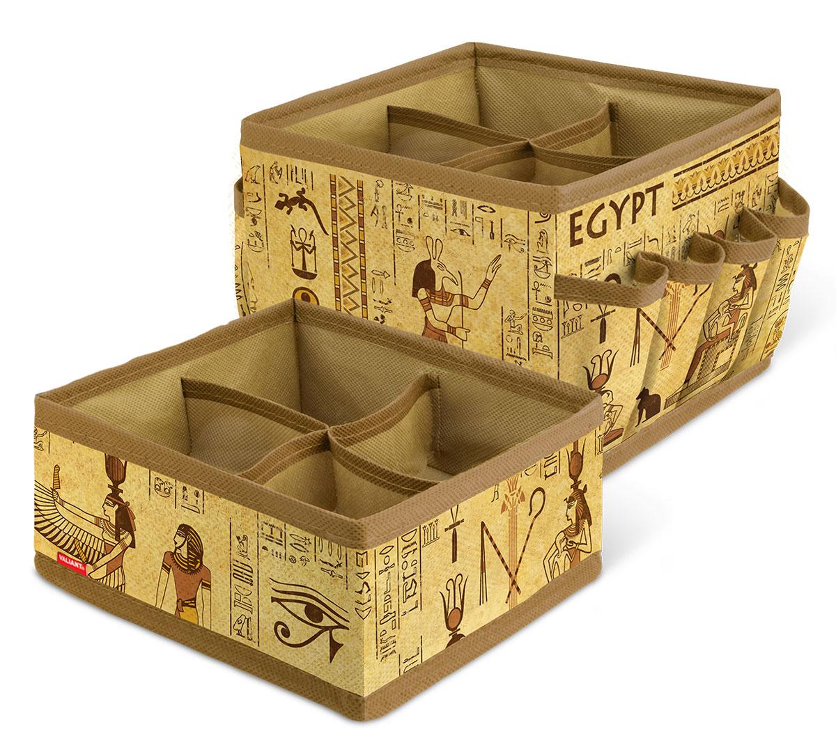 Набор органайзеров для косметики и аксессуаров Valiant Egypt, 2 штEG-S4S4Набор Valiant Egypt состоит из двух органайзеров для хранения косметики и аксессуаров. Изделия выполнены из высококачественного нетканого материала (спанбонда), который обеспечивает естественную вентиляцию, позволяя воздуху проникать внутрь, но не пропускает пыль. Вставки из плотного картона хорошо держат форму. Мягкие перегородки образуют четыре секции для хранения разнообразной косметики. Наружные кармашки позволяют удобно хранить мелкие аксессуары. Изделия отличаются мобильностью: легко раскладываются и складываются. Набор органайзеров для косметики и аксессуаров Valiant Egypt поможет привести элементы женского туалета в порядок. Оригинальный дизайн придется по вкусу ценительницам эстетичного хранения. Размер органайзеров: 15 см х 15 см х 12 см; 15 см х 15 см х 7 см.