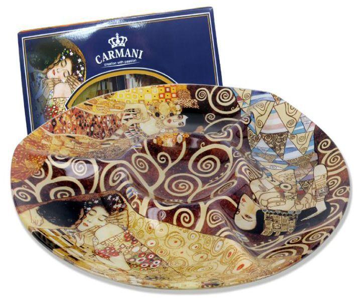 Менажница Carmani Г. Климт, 29,6х2,5 смCAR198-8061-ALТорговая марка Carmani (Польша) известна с XIX века. Основатель марки, Престон Кармани, принадлежал к высшему свету Европы, известному своими прогрессивными идеями и тягой к искусству. Конкурентными преимуществами марки Carmani является высокое качество продукции и неповторимый дизайн. Процесс разработки нового предмета представляет собой сочетание традиционных методов и современных компьютерных технологий. Следует отметить, что каждая серия кружек Carmani имеет яркую индивидуальность, оригинальный дизайн и отражает разные темы, связанные с развитием и культурой человечества. Стеклянные тарелки и карманные зеркала с изображением прекрасных дам с полотен известных художников, выпускаются ограниченным тиражом и имеют коллекционную ценность.