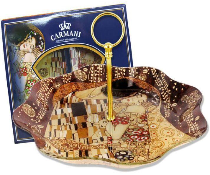 Менажница Carmani Г. Климт, с ручкой, на вращающейся подставке, 30x30х5 смCAR198-8091-ALТорговая марка Carmani (Польша) известна с XIX века. Основатель марки, Престон Кармани, принадлежал к высшему свету Европы, известному своими прогрессивными идеями и тягой к искусству. Конкурентными преимуществами марки Carmani является высокое качество продукции и неповторимый дизайн. Процесс разработки нового предмета представляет собой сочетание традиционных методов и современных компьютерных технологий. Следует отметить, что каждая серия кружек Carmani имеет яркую индивидуальность, оригинальный дизайн и отражает разные темы, связанные с развитием и культурой человечества. Стеклянные тарелки и карманные зеркала с изображением прекрасных дам с полотен известных художников, выпускаются ограниченным тиражом и имеют коллекционную ценность.