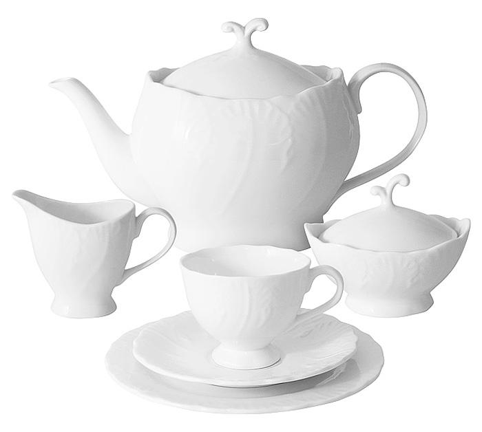 Чайный сервиз Emerald Белый город, 21 предмет, 6 персон. E6-SM077/21ALE6-SM077/21ALЧайный сервиз Белый город 21 предмет на 6 персон (6 чашек 0,15л; 6 блюдец; 6 тарелок 19см, чайник1,0л, сахарница 0,1л, молочник 0,1л) Чайная и обеденная столовая посуда торговой марки Emerald произведена из высококачественного костяного фарфора. Благодаря высокому качеству исполнения, разнообразным декорам и оптимальному соотношению цена – качество, посуда Emerald завоевала огромную популярность у покупателей и пользуется неизменно высоким спросом. Изделия Emerald представлены как в виде обеденных и чайных сервизов на 6 и 12 персон. Поверхность изделий покрыта превосходной сверкающей глазурью, не содержащей свинца.