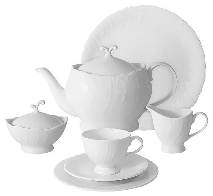 Чайный сервиз Emerald Белый город, 40 предметов, 12 персон. E6-SM077/40ALE6-SM077/40ALЧайный сервиз Белый город 40 предметов на 12 персон (12 чашек 0,15л; 12 блюдец; 12 тарелок 19см, чайник1,0л, сахарница 0,1л, молочник 0,1л, блюдо 42х21см) Чайная и обеденная столовая посуда торговой марки Emerald произведена из высококачественного костяного фарфора. Благодаря высокому качеству исполнения, разнообразным декорам и оптимальному соотношению цена – качество, посуда Emerald завоевала огромную популярность у покупателей и пользуется неизменно высоким спросом. Изделия Emerald представлены как в виде обеденных и чайных сервизов на 6 и 12 персон. Поверхность изделий покрыта превосходной сверкающей глазурью, не содержащей свинца.