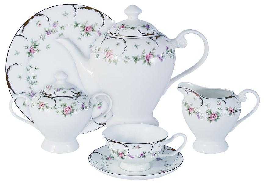 Чайный сервиз Emerald Розмари, 21 предмет, 6 персон. E6-XR14C29G-02/21M-ALE6-XR14C29G-02/21M-ALЧайный сервиз Розмари 21 предмет на 6 персон (6 чашек 0,175л; 6 блюдец; 6 тарелок 21см, чайник1,2л, сахарница 0,35л, молочник 0,35л) Чайная и обеденная столовая посуда торговой марки Emerald произведена из высококачественного костяного фарфора. Благодаря высокому качеству исполнения, разнообразным декорам и оптимальному соотношению цена – качество, посуда Emerald завоевала огромную популярность у покупателей и пользуется неизменно высоким спросом. Изделия Emerald представлены как в виде обеденных и чайных сервизов на 6 и 12 персон. Поверхность изделий покрыта превосходной сверкающей глазурью, не содержащей свинца.