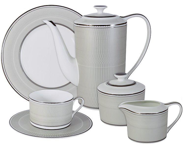 Чайный сервиз Naomi Маренго, 21 предмет, 6 персон. NG-I150905C-21-AlNG-I150905C-21-AlЧайный сервиз Маренго 21 предм.на 6 персон (6 чашек 0.25л, 6 блюдец, 6 тарелок 21.5см, чайник 1.4л, сахарница 0.35л, молочник 0.25л ) Чайная и обеденная посуда торговой марки Naomi из высококачественного костяного фарфора отличается прекрасными дизайнами, исполненными как в современном, так и в классическом стиле по разработкам современных японских художников. Все изделия изготавливаются на современном оборудовании по новейшим технологиям и проходят строгий контроль качества.