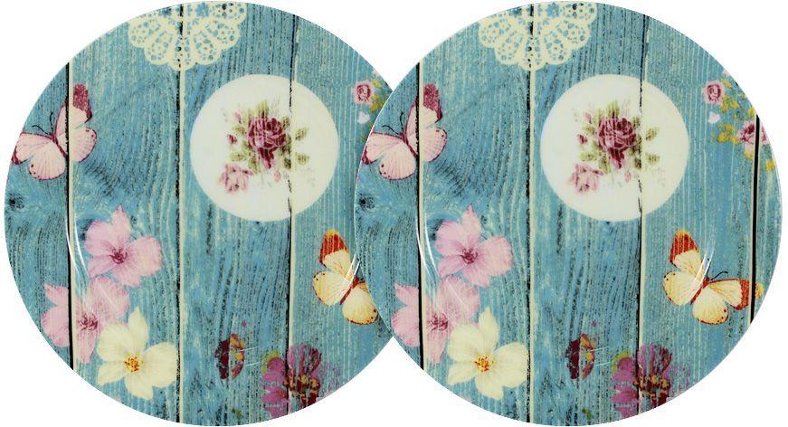Набор закусочных тарелок Primavera Фантазия, диаметр 20,5 см, 2 штPWW-150118-20ALНабор Primavera Фантазия состоит из 2 закусочных тарелок, изготовленных из фарфора с добавлением костной золы (7-15%), благодаря которой фарфор получается прозрачным и прочным. Изделия легкие, белоснежные, прочные. Нанесение сверкающей глазури, не содержащей свинца, придает изделиям превосходный блеск и особую прочность. Такие тарелки отлично подойдут для подачи закусок или десертов. Они оригинально дополнят сервировку стола и станут практичным приобретением для кухни. Серия посуды Фантазия - это не просто изделия из костяного фарфора, тонкие и изящные, это посуда для любителей неформального, слегка состаренного дизайна в ярких голубых тонах. Изделия украшены изображением потертого бруса в окружении порхающих бабочек. Посуда подходит для ежедневного использования. Благодаря отсутствию серебряной и золотой отделки посуду можно мыть в посудомоечной машине, а также использовать в микроволновой печи.