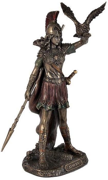 Статуэтка Veronese Афина, высота 20 смVWU76947A4ALДекоративная статуэтка Veronese Афина изготовлена из полистоуна бронзового цвета. Изделие выполнено в виде греческой богини войны и мудрости - Афины, с совой и копьем в руке. Вы можете поставить статуэтку в любом месте, где она будет удачно смотреться и радовать глаз. Такая фигурка прекрасно дополнит интерьер офиса или дома. Veronese - это торговая марка, представляющая широкий ассортимент художественных изделий из полистоуна, выполненных по эскизам итальянских дизайнеров и художников. Полистоун представляет собой специальную массу с полимерными связующими материалами, которые абсолютно не токсичны. Имя Veronese является синонимом высокого качества, художественного вкуса и эксклюзивного дизайна. Искусные мастера создают уникальные статуэтки и фигурки, которые призваны украсить вашу жизнь.