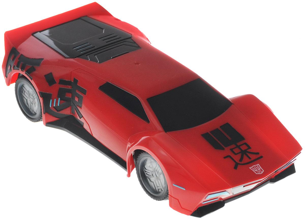 Dickie Toys Машина на радиоуправлении Sideswipe3114001Машина на радиоуправлении Dickie Toys Sideswipe с неоновой подсветкой непременно понравится любому поклоннику трансформеров. Sideswipe - это автобот, один из главных героев мультфильма Трансформеры. Игрушка полностью повторяет свой экранный прототип, выполнена в масштабе 1:24. Машина изготовлена из безопасного и прочного пластика с элементами из металла. С помощью пульта управления машина может двигаться вперед-назад, влево-вправо, останавливаться, имеется функция Турбо. Особую реалистичность игре с машиной придает неоновая подсветка дисков. Игрушка станет главным действующим лицом увлекательной игры по сюжету мультфильма или ребенок сможет придумать новую историю, проявив свою фантазию. Пульт управления работает на частоте 2,4 GHz. Для работа машины рекомендуется купить 3 батарейки напряжением 1,5V типа АА (не входят в комплект). Для работы пульта управления рекомендуется купить 3 батарейки напряжением 1,5V типа AAA (не входят в комплект).