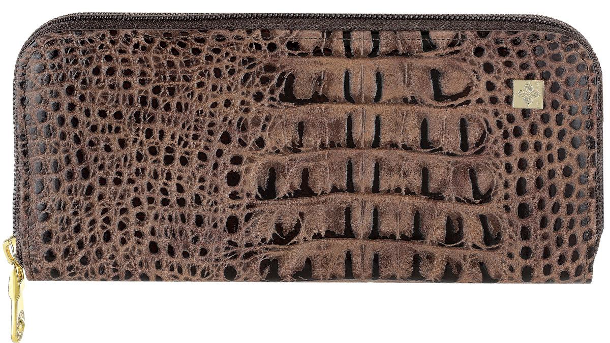 Портмоне женское Dimanche Loricata, цвет: темно-коричневый. 537/8537/8_коричневыйСтильное женское портмоне Dimanche Loricata выполнено из натуральной кожи с тиснением под рептилию. Изделие оформлено металлической пластинкой с логотипом бренда. Внутри расположены четыре вместительных отделения для купюр, два отделения для мелочи на молнии и один карман для мелких бумаг. Также внутри находятся шесть открытых накладных карманов для визитных и дисконтных карт. Изделие застегивается на застежку-молнию. Портмоне упаковано в фирменную коробку.