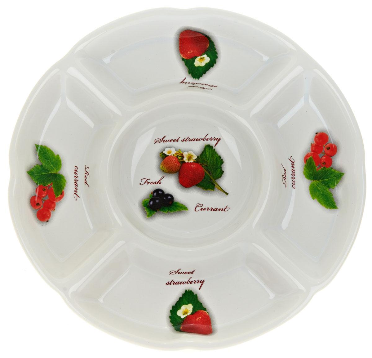 Менажница ENS Group Садовая ягода, 5 секций, диаметр 24 см. L2520284L2520284Менажница Садовая ягода, изготовленная из высококачественной керамики. Менажница состоит из 5 секций, предназначенных для подачи сразу нескольких видов закусок, нарезок, соусов и варенья. Оригинальная менажница станет настоящим украшением праздничного стола и подчеркнет ваш изысканный вкус. Можно мыть в посудомоечной машине.