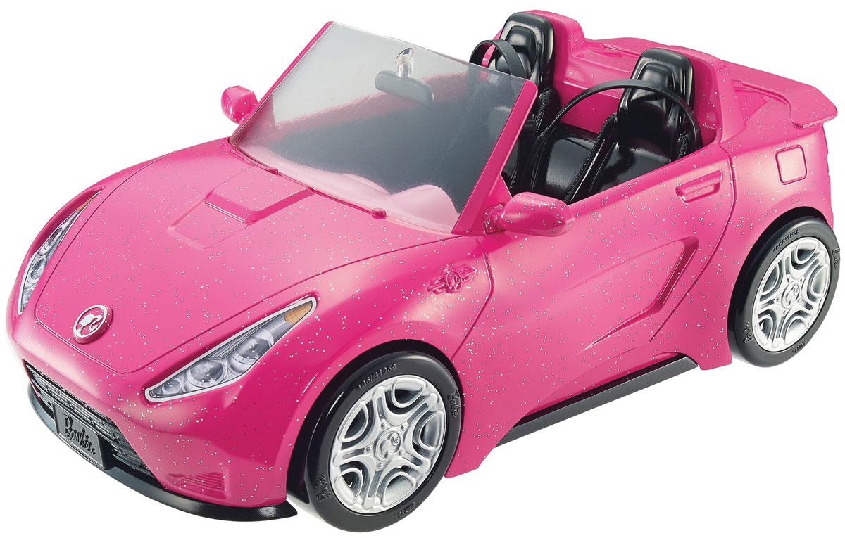 Barbie Кабриолет для куколDVX59Машинка для куколок Barbie Кабриолет разнообразит игры вашей дочурки. Розовый сверкающий кабриолет с серебристыми деталями удивит всех вокруг. Он просто воплощение стиля Barbie. Теперь у куклы Барби будет свой собственный открытый автомобиль всем на зависть! На этой спортивной машинке можно умчаться навстречу приключениям, а можно и съездить за модными покупками. Снаружи машина украшена блестками и реалистичными деталями с символикой Барби. Внутри кабриолета эффектные черные сиденья снабжены ремнями безопасности. Машина укомплектована зеркалом заднего вида и боковыми зеркалами. Колеса свободно крутятся. Внутри с удобством разместятся две куколки Барби. Фары кабриолета выполнены в виде наклеек, руль крутится. Машина изготовлена из безопасного пластика. Ваша малышка теперь сможет катать свою любимую куклу и ее подружек. Порадуйте ее таким замечательным подарком! Куклы продаются отдельно.