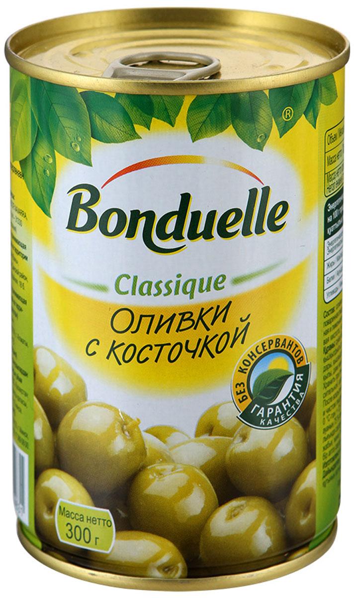 Bonduelle оливки с косточкой, 300 г3469Оливки с косточкой Bonduelle сочетают в себе изысканный вкус и чрезвычайно полезные свойства. Молодые плоды оливкового дерева, проходя процесс консервации, практически не утрачивают своей ценности. Оливки богаты калием, кальцием и железом, содержат витамины групп B, C, E, полезные органические вещества. Употребление оливок благотворно влияет на различные процессы организма, например, способствует улучшению микрофлоры кишечника, укрепляет стенки сосудов, регулирует процессы свертывания крови. Удивительно вкусные, ароматные оливки идеально сочетаются с вином и сыром, а также прекрасно дополняют различные закуски. Уважаемые клиенты! Обращаем ваше внимание, что полный перечень состава продукта представлен на дополнительном изображении.