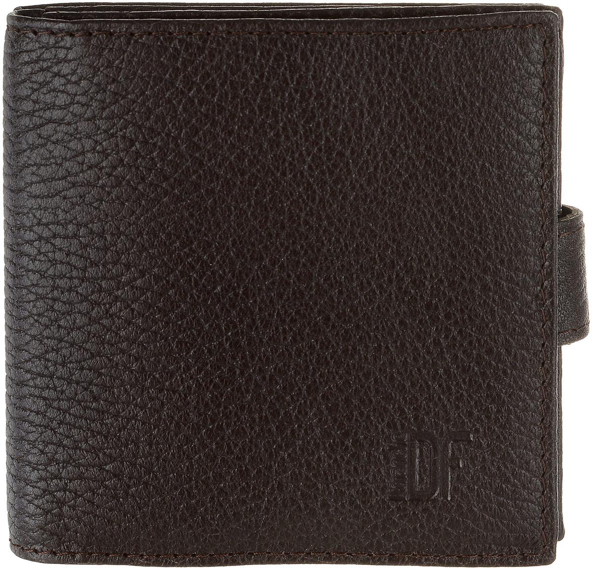 Кошелек мужской Dimanche Street Brun, цвет: темно-коричневый. 196196Стильный мужской кошелек Dimanche Street Brun изготовлен из натуральной высококачественной фактурной кожи. Он состоит из двух отделений. Одно закрывается на застежку-кнопку, внутри него находятся три кармашка для пластиковых карт и визиток, кармашек для мелких бумаг и карман для монет с клапаном на застежке-кнопке. Второе отделение имеет два кармана для купюр и закрывается хлястиком на магнитной кнопке. Между отделения имеется потайной кармашек. Стильный кошелек эффектно дополнит ваш образ и станет незаменимым аксессуаром. Упаковано изделие в фирменную картонную коробку.